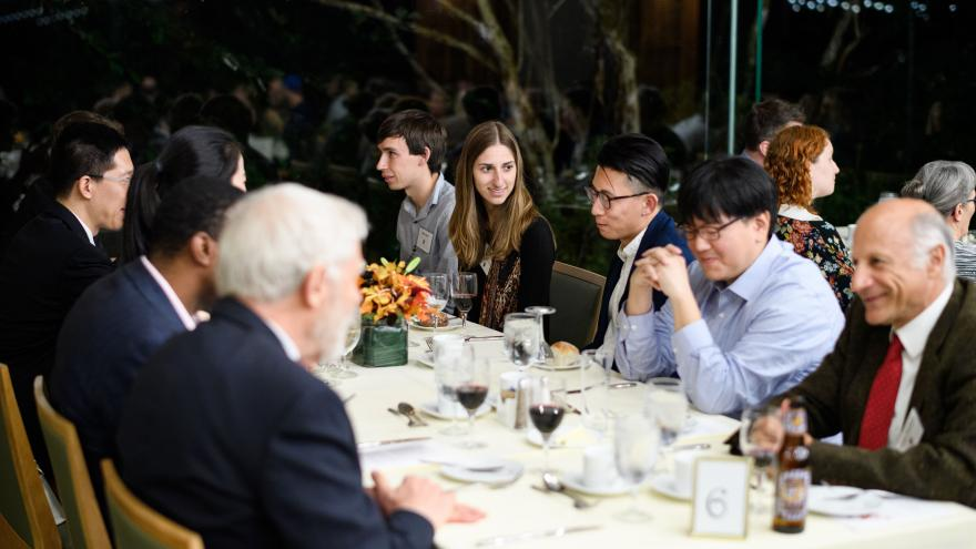 photo shows students and faculty at awards dinner at Prospect House