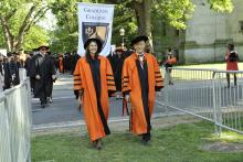 Hooding cermony procession led by Chief University Marshals
