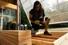Graduate student Austen Kernodle fabricating part of the shed.